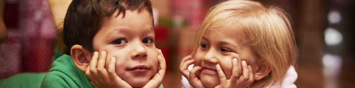 Two preschool-aged children representing the holidays with your preschooler