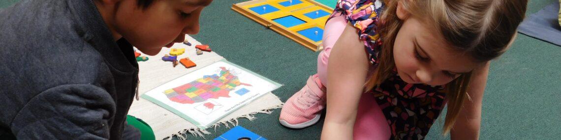 Two kindergarteners at a Montessori Kindergarten participating in advanced study