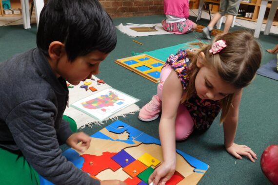Two kindergarteners at a Montessori Kindergarten participating in advanced study