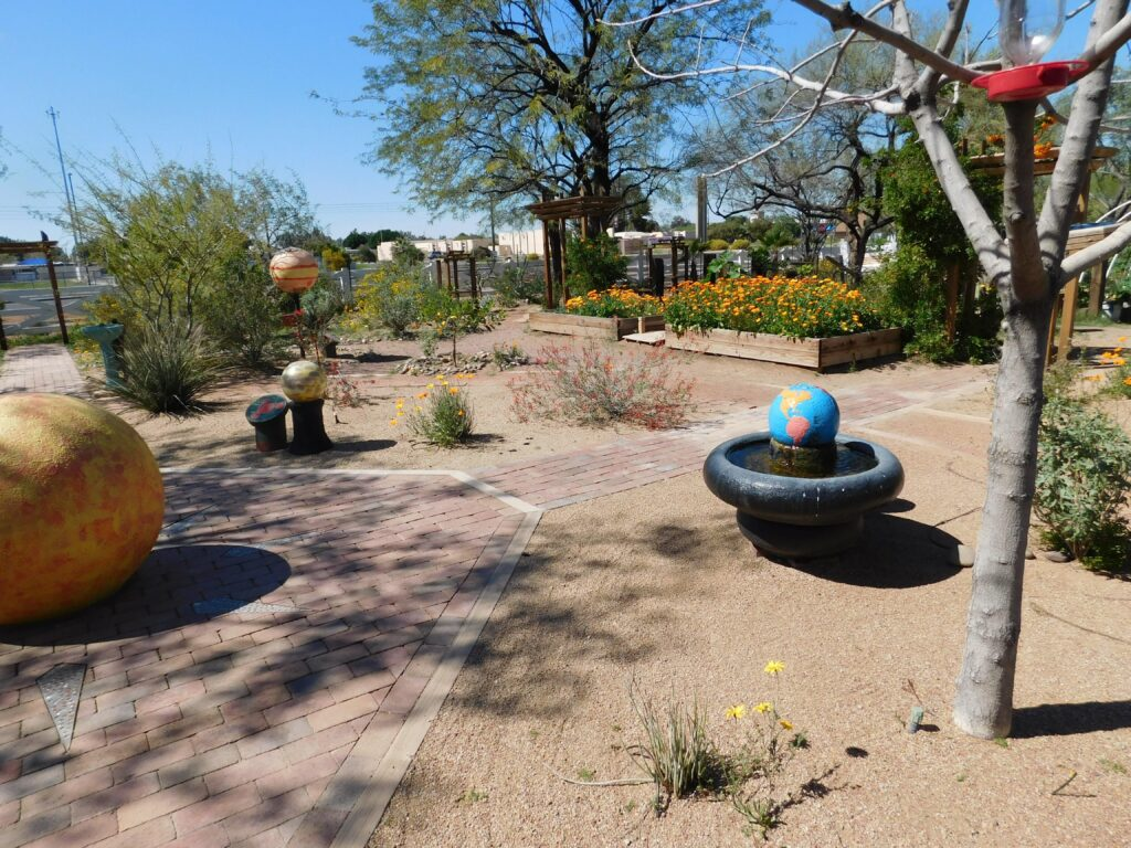 Outdoor model solar system in a Montessori preschool showing nature-based learning