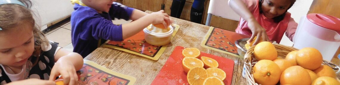 Children preparing food as part of Montessori at home