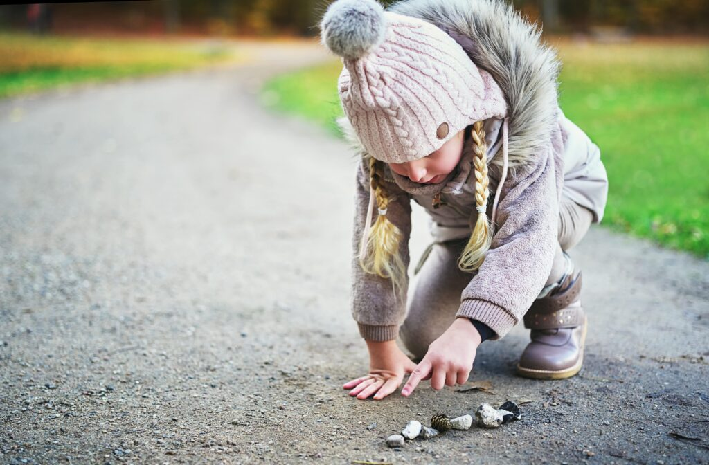 Child counting stones as part of Montessori in the home