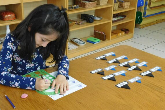 Student practices self-directed learning in preschool