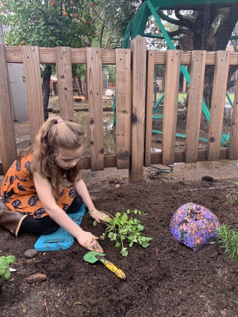 preschooler doing outdoor spring montessori activity