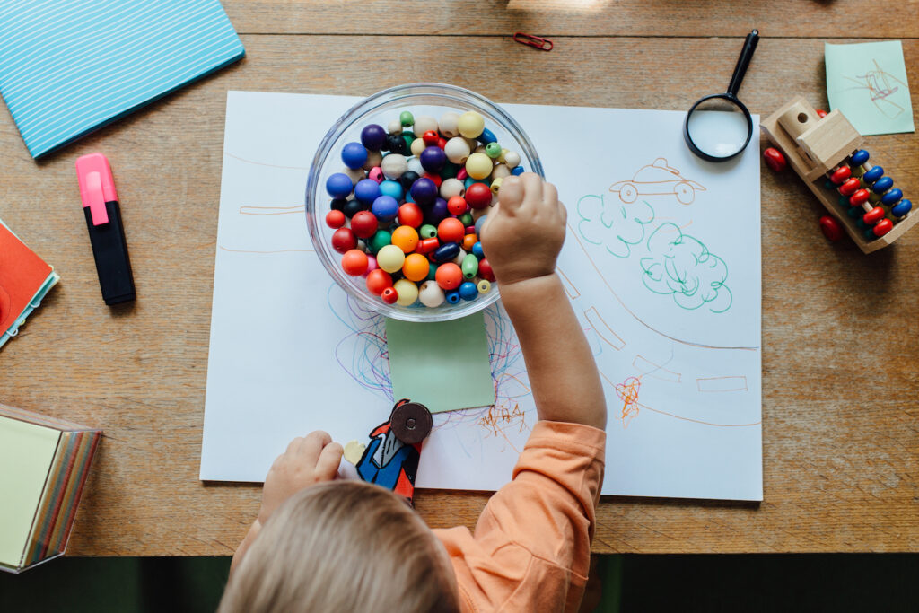 Preschooler practicing sorting beads as part of stay-at-home Montessori
