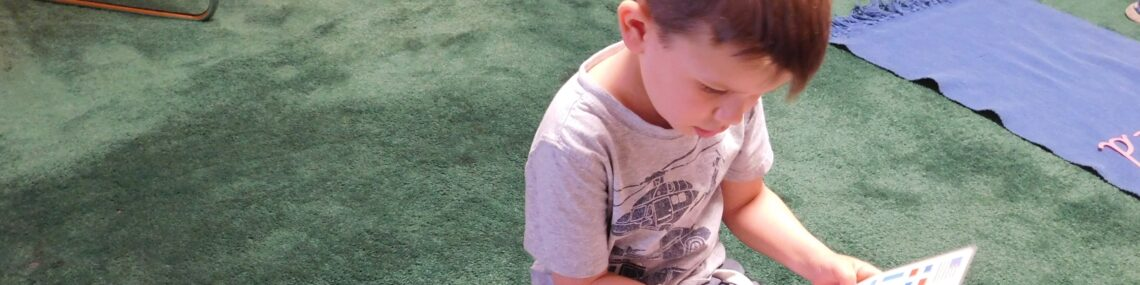Preschooler completes independent schoolwork while practicing Montessori and social distancing