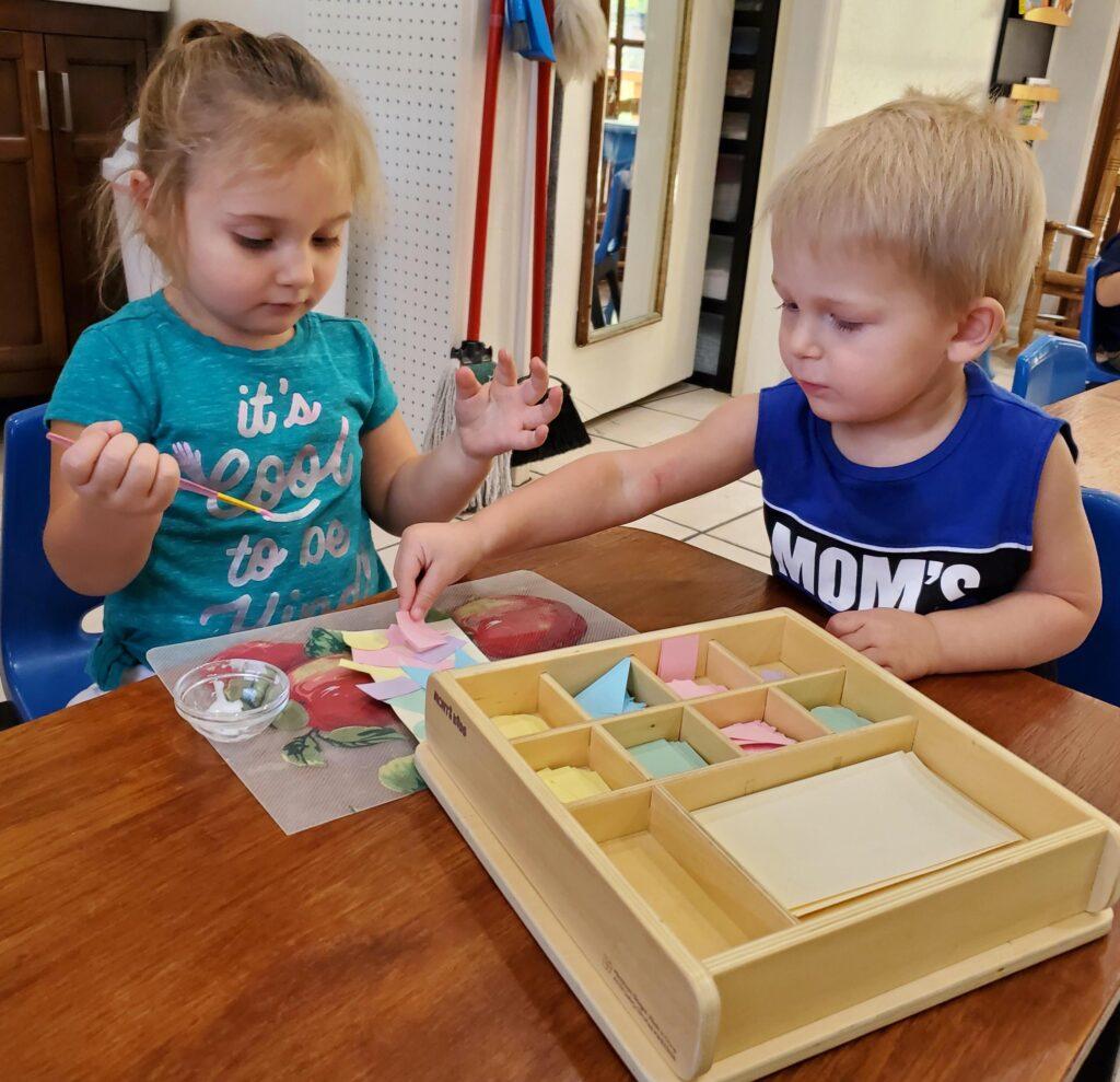 Children doing Montessori work at a Montessori toddler program