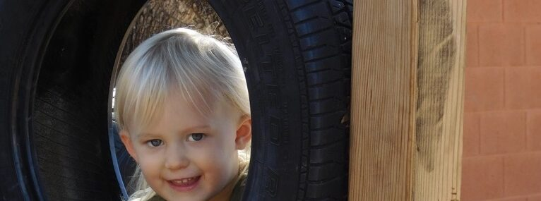 preschooler smiling on playground showing confidence and resilience in children