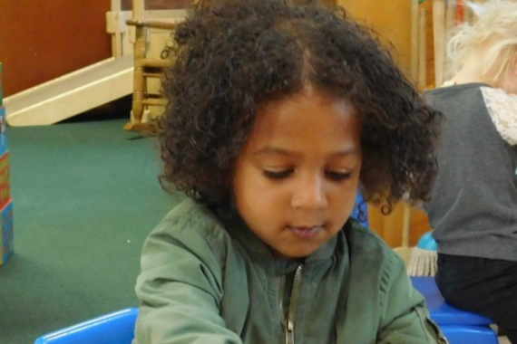 Toddler playing at Montessori